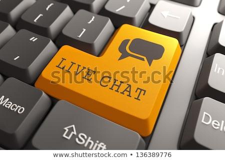 live chat on orange keyboard button stock photo © tashatuvango