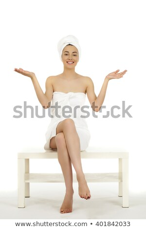 Stock photo: Pretty woman wrapped in towel in bathroom