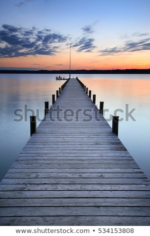 wooden pier on the lake at sunset stock photo © kayco