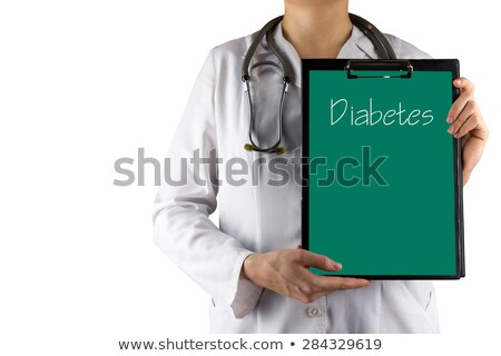 female doctorholding diabetes sign stock photo © ichiosea