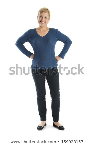 Mature woman standing with hand on hip Stock photo © bmonteny