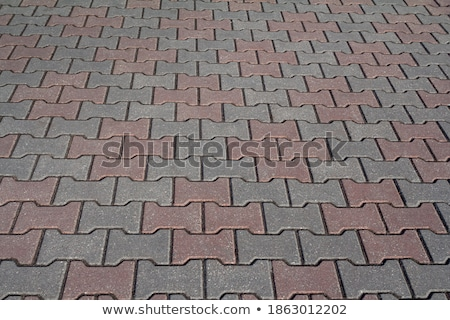 Gray Pavement  Slabs Laid in Pattern. Stock photo © tashatuvango
