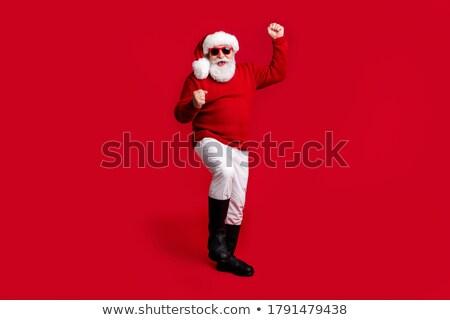 successful man in sweater wearing winter cap and sunglasses stock photo © feelphotoart