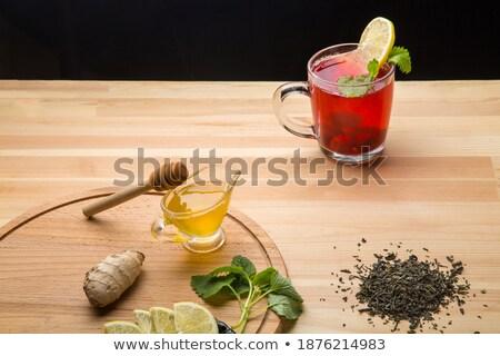 delicious tea on the table next to lemon stock photo © justinb