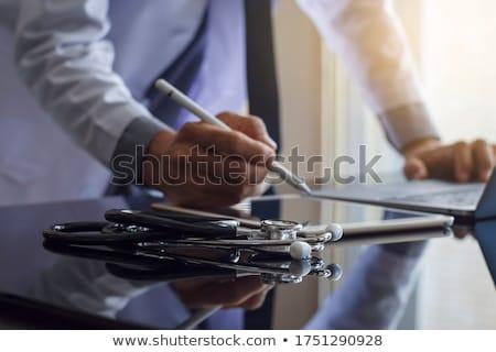 Doctor with stethoscope in hand Stock photo © Klinker