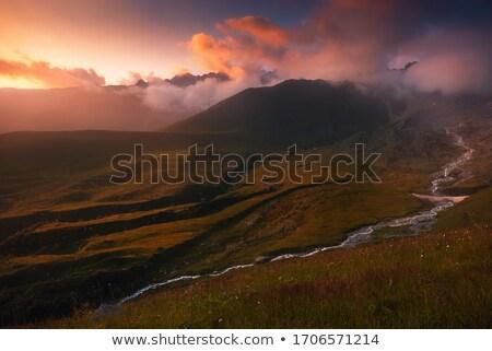 Last rays of sunshine on Caucasus mountains in Georgia Stock photo © Taigi