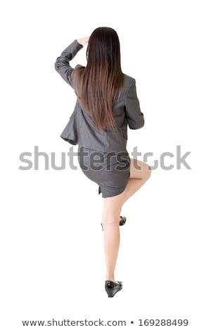 Femme d'affaires montée quelque chose isolé affaires femme Photo stock © fuzzbones0