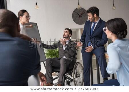 Zakenvrouw rolstoel werken collega kantoor vrouw Stockfoto © wavebreak_media