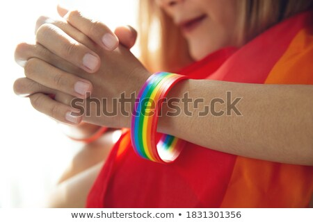 gay couple holding hands, patterned as the rainbow flag Stock photo © nito