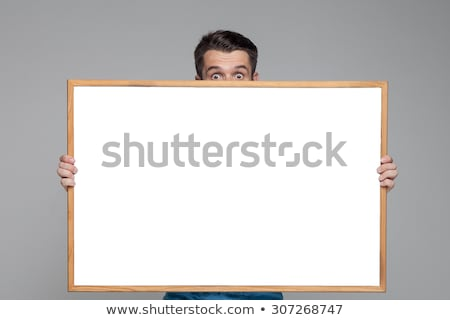Meglepődött férfi mutat üres fehér óriásplakát Stock fotó © master1305