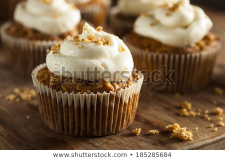 Stock fotó: Carrot Cupcakes Decorated With Cream Cheese Frosting