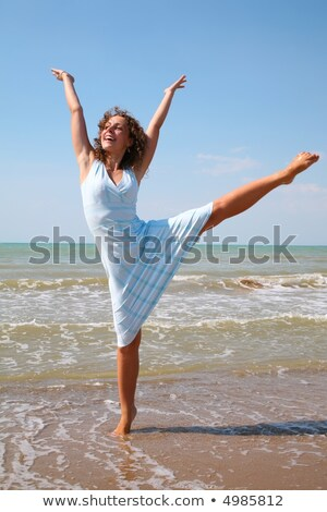 young woman makes exercise on the edge of the sea stock photo © Paha_L