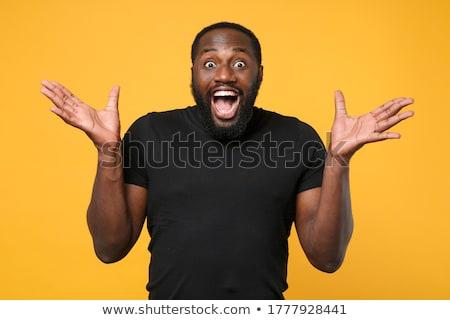 Man with Beard and Curly Hair Wearing Dark T-Shirt Stock photo © ozgur