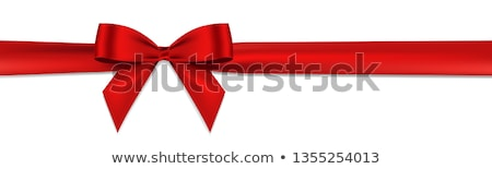 Holiday background with realistic shiny red satin gift bow and ribbon Stock photo © Fosin