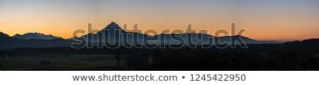 Laranja pôr do sol montanhas natureza paisagem mar Foto stock © Burchenko