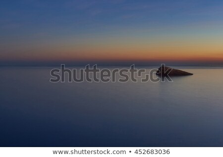 Sunset over the Benidorm Island and the Mediterranean Sea. Spain Stock photo © amok