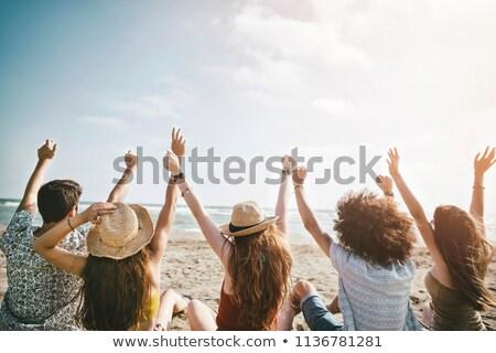 hombre · celular · teléfono · playa · verano · sonriendo - foto stock © lubavnel