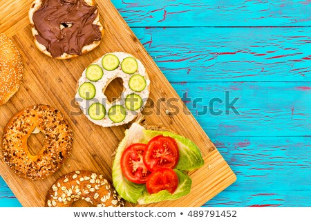 Sliced fresh bagels with delicious trimmings Stock photo © ozgur