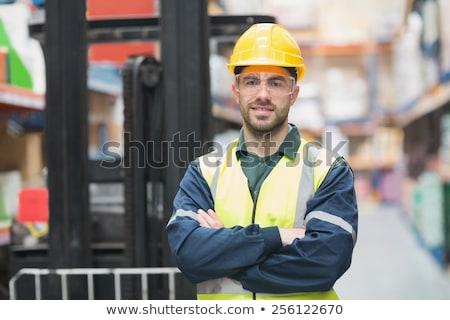fiatal · jóképű · férfi · pózol · kalap · áll · fehér - stock fotó © deandrobot
