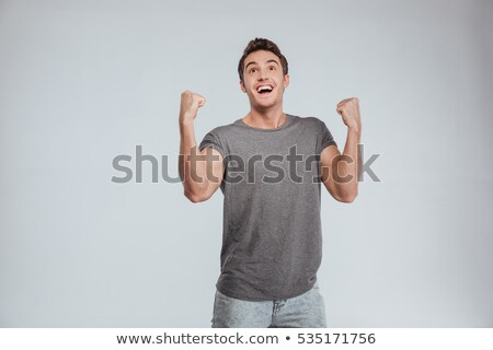szczęśliwy · młody · człowiek · krzyczeć · szary - zdjęcia stock © deandrobot