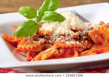 Bow tie pasta and tomato passata Stock photo © Digifoodstock