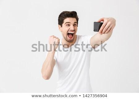 Boldog üzletember beszél telefon gyártmány nyertes Stock fotó © deandrobot