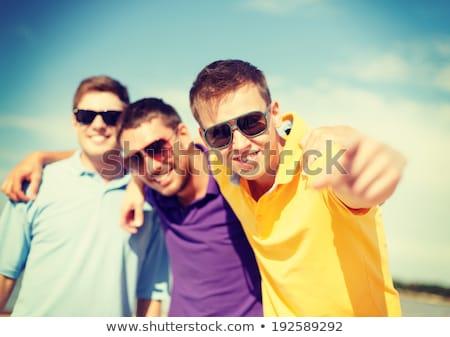 Atractivo jóvenes caminando playa agua Foto stock © meinzahn
