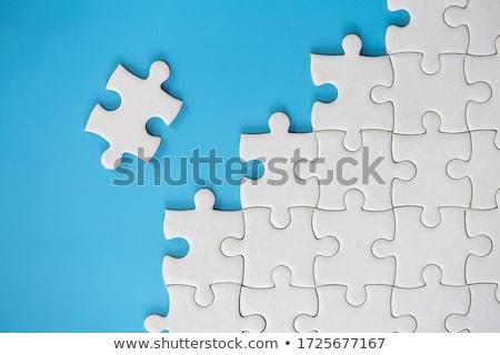 Solution - Jigsaw Puzzle with Missing Pieces. Stock photo © tashatuvango