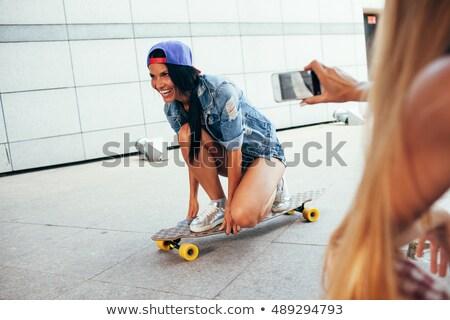 Eine Frau Schießen andere ein Brünette Frau Stock foto © chesterf