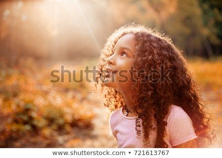 Menina sol grama diversão energia Foto stock © IS2