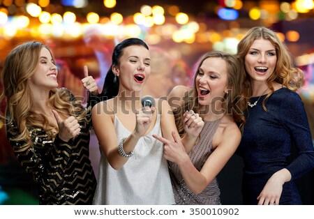 Groep vrouwen vrouw partij microfoon glimlachend Stockfoto © IS2