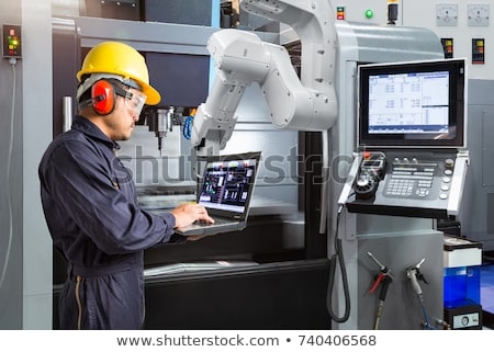 Engineer programming a robotic hand. Stock photo © RAStudio
