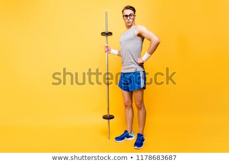 full length photo of young sporty man exercising with dumbbell stock photo © deandrobot