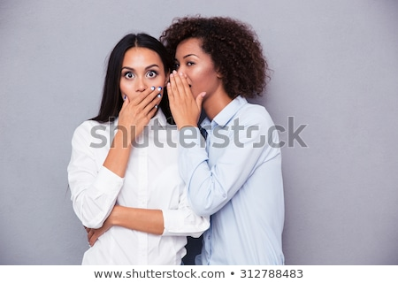 women whispering and laughing stock photo © is2