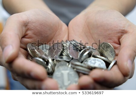 Dollar valuta geld financieren revolver hand Stockfoto © studiostoks