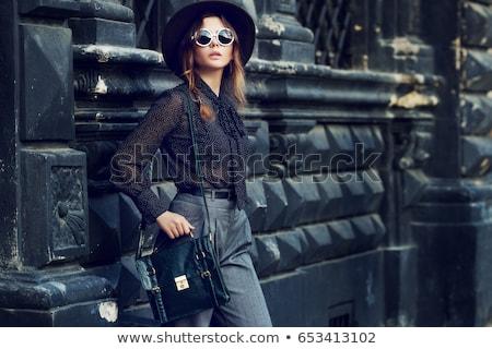 Fashion model wearing green pants and white shirt Stock photo © DenisMArt