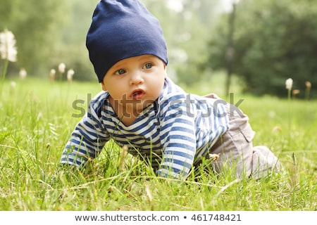 Outdoor portrait of a baby on all fours. crawling on knees child Stock photo © Yatsenko