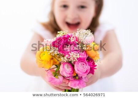 beautiful girl holding a pink ranunculus flower stock photo © artjazz