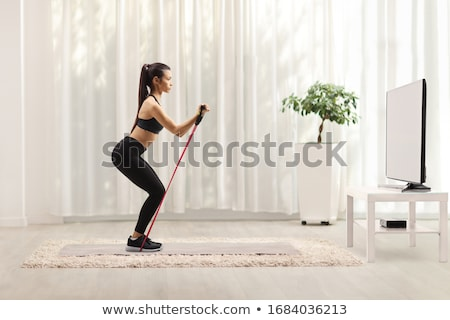 Woman exercising with resistance band Stock photo © IS2