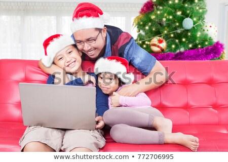 улыбаясь · Рождества · человека · Hat - Сток-фото © is2