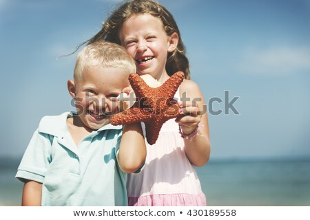 Girl at beach with starfish Stock photo © IS2