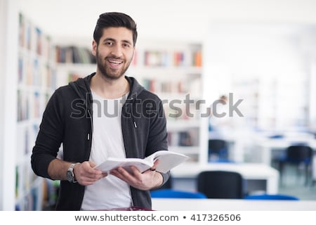 Stock photo: A Middle Eastern Boy Reading A Book