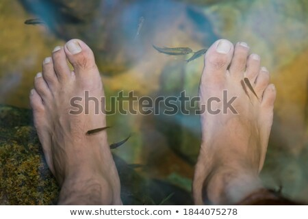 Férfi pedikűr fürdő férfi ül szabadidő Stock fotó © IS2