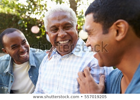 Parents in garden with arms around son Stock photo © IS2