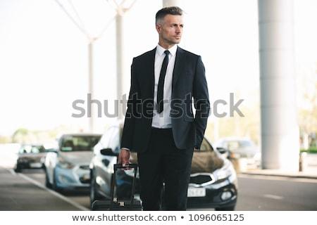 Olgun işadamı taksi yürüyüş dışında havaalanı Stok fotoğraf © deandrobot