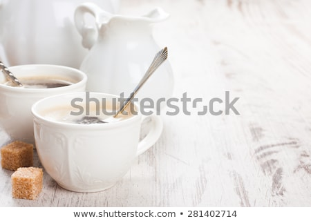 cup of coffee with sugar cubs and milk jug stock photo © melnyk