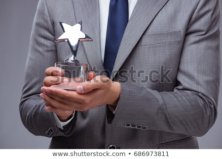 Businessman winning best employee of the month award Stock photo © Elnur