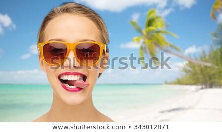 Mulher língua verão praia viajar Foto stock © dolgachov