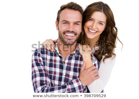 portrait of a smiling young couple standing together stock photo © deandrobot