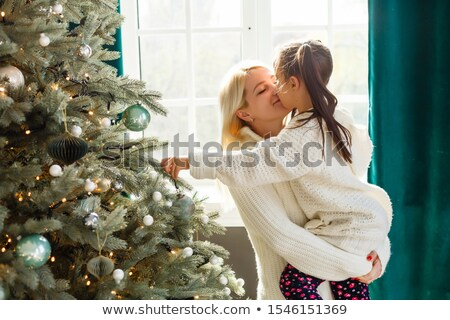 Children rejoice at the Christmas tree Stock photo © liolle